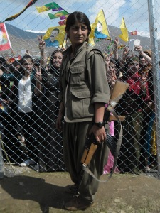 PKK fighter bearing arm, Newroz 2014, Qandil mountains. Photo: Fréderike Geerdink