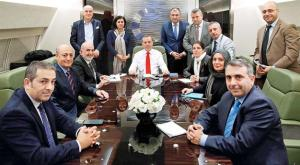 Akif Beki with Erdogan in the presidential plane. He is the first on the left.