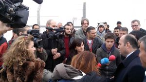 Journalists on a forced tour in the stsate refugee camp, talking to the governour.