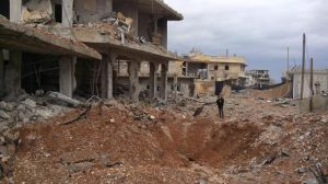 Destruction inside Kobani, and a French journalist reporting it.
